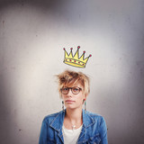 Upset young woman with little crown