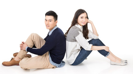 Young Asian couple sit on ground