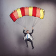 Businessman with parachute