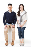 Portrait of young Asian couple sit