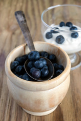 bowl of blueberries on wooden table