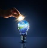 invest in solar energy -  concept - sun in bulb - piggybank - 62378596