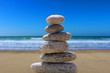 zen balance stone on the beach 6