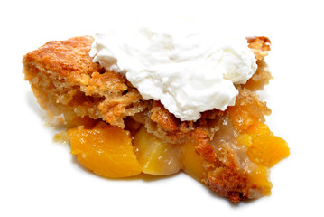 Whipped Cream on a Slice of Peach Cobbler