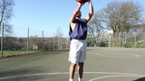 Basketball player dribbling and scoring a jump shot