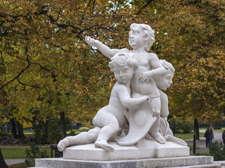 Vienna , Austria. Sculpture in urban public park in autumn