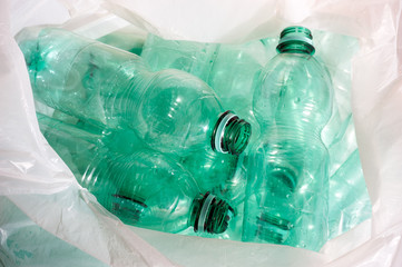green plastic bottles sorted for recycling