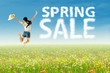A girl jumping with spring sale clouds