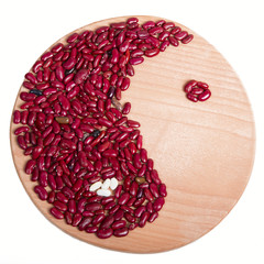 yin yang, beans on a wooden board