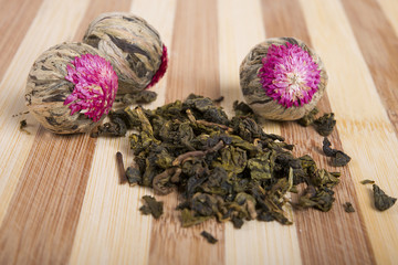 herbal flower and milk oolong  tea on wooden kitchen table