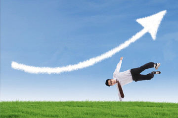 Businessman perform success move under up arrow cloud