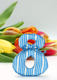 Figure 8 and colorful tulips, close-up