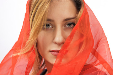 Woman in red silk headscarf