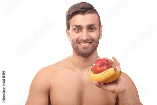 Healthy smiling man with fruits
