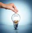 Leinwanddruck Bild - invest to energy concept - euro in bulb - piggybank