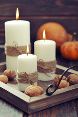 Candles with nuts and pumpkin