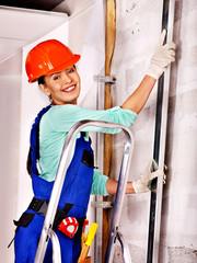 Woman in builder uniform.