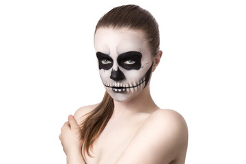 Portrait of young woman with skull make-up. Isolated on white.