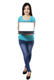 Woman showing a laptop