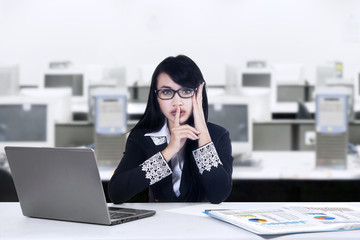 Woman making silence gesture