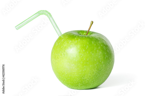 Green apple with a straw isolated on white.