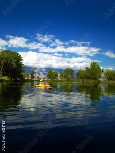 Woman relaxing in her kayak floating on the water