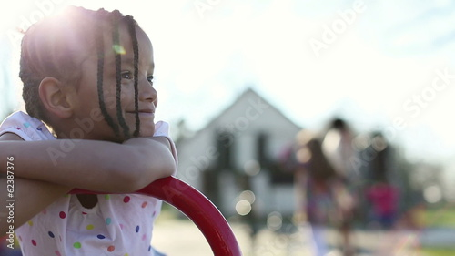 Portrait of a pretty young girl smiling in a playground