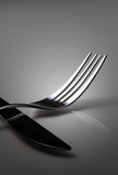 Silver fork with a knife in the shadow