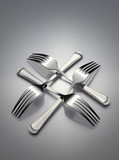 The four interlocking silver forks