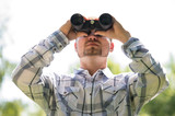 Man with Binoculars outdoors
