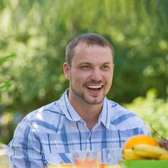 Man Enjoying Meal In Garden