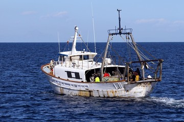 Trawler fishing boat working in open waters
