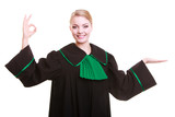 Woman lawyer attorney in classic polish gown making ok hand sign