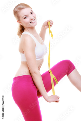 Fitness girl sporty woman measuring her thigh isolated