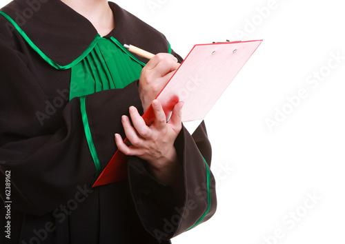 Lawyer attorney in classic polish gown writing on clipboard