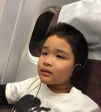 boy listening music on the plane