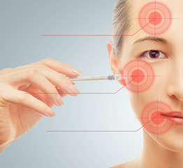 Woman holds a syringe near the face