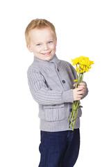 Cute Romantic little boy holding flowers