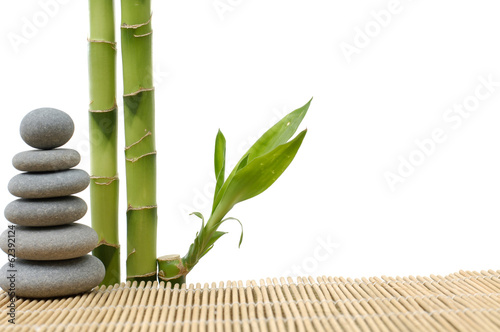 Foto op Plexiglas Bamboe Stone tower with bamboo grove on bamboo stick straw mat
