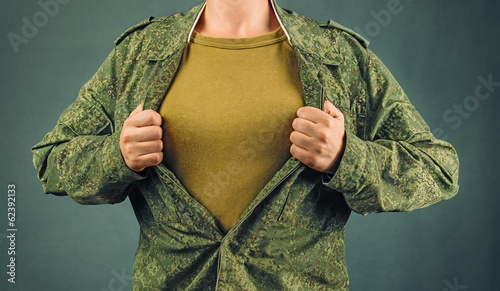 Military woman opens her shirt, copyspace