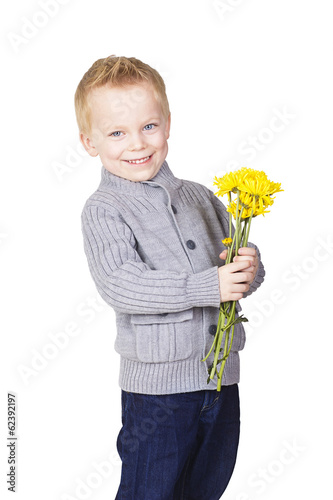 Cute Romantic little boy holding flowers