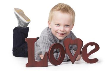 Adorable little boy sending out a message of love