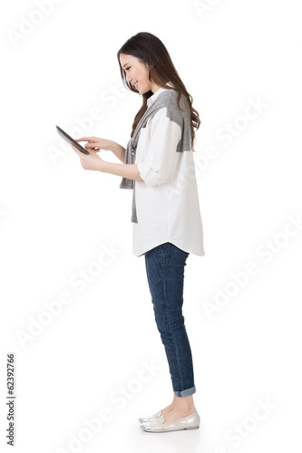 Attractive young Asian woman using pad