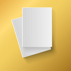 Blank white books on yellow background
