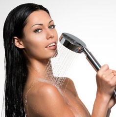 sexy beautiful woman holds shower in hands