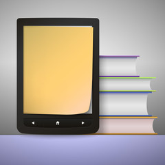 Stack of colorful books with electronic book reader.