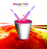 Holi colorful spalsh with bucket full of colors and pichkari in