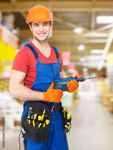 Portrait of smiling handyman with drill