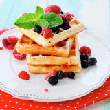 stack waffles with  ripe summer berry