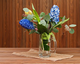 Bouquet from tulips and hyacinths on wooden background.